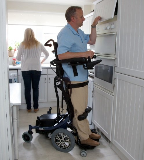 User at home in standing wheelchair